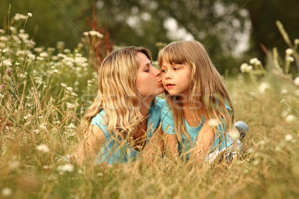 Mom and her little daughter on the grass Stock photo © koca777