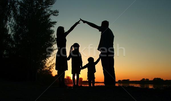 силуэта счастливая семья детей пляж небе дома Сток-фото © koca777