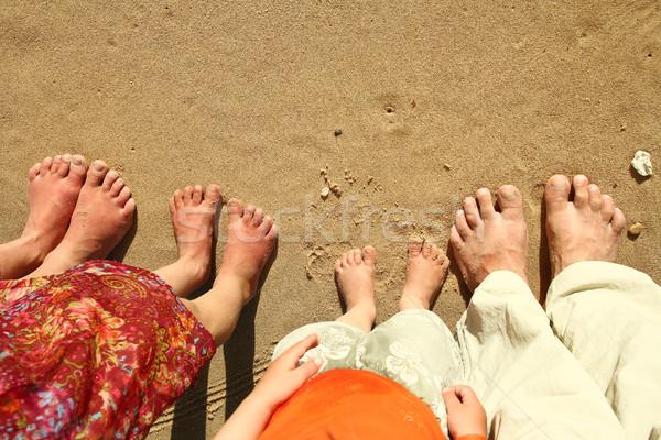 Family feet on the sand on the beach Stock photo © koca777