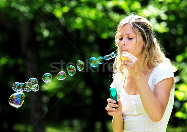Fiatal nő buborékfújás kint nő kéz férfi Stock fotó © koca777
