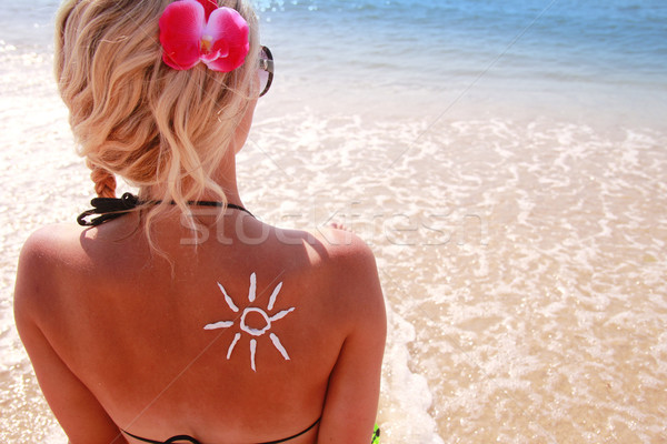 of sun cream on the female back on the beach Stock photo © koca777