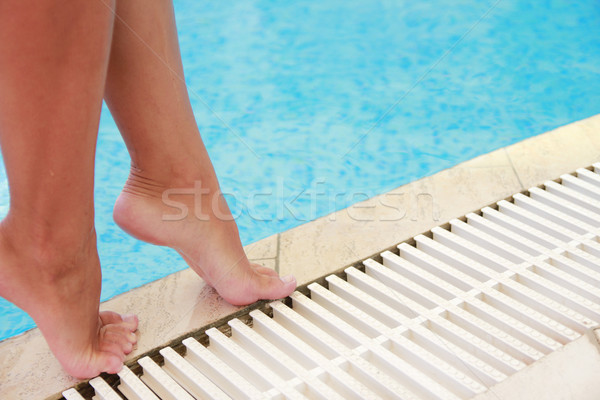 female legs in the water pool Stock photo © koca777