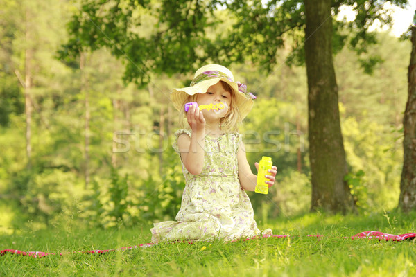 little girl with soap bubbles Stock photo © koca777