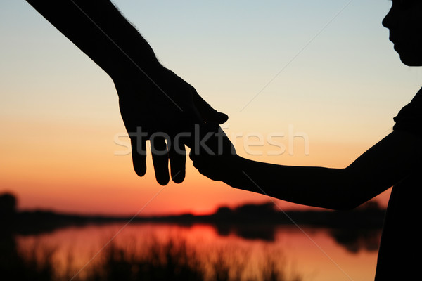 silhouette parent and child hands Stock photo © koca777