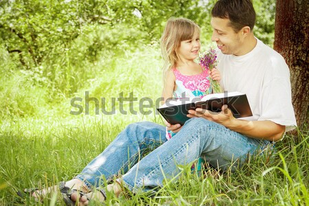 Young family reading the Bible  Stock photo © koca777