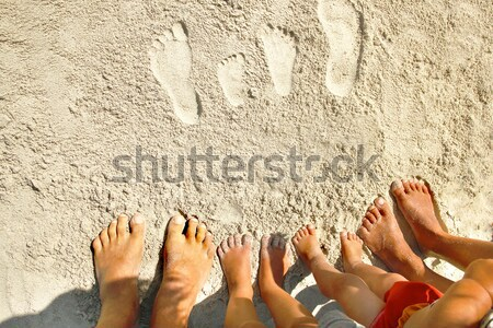 family footprints in the sand on the seashore Stock photo © koca777