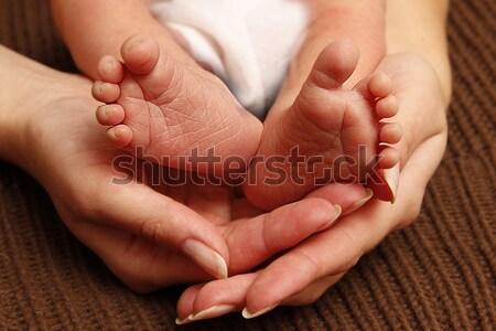 leg newborn little baby in the mother's hands  Stock photo © koca777