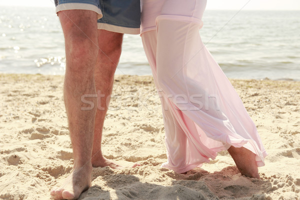 Enceintes couple amour pieds plage femme Photo stock © koca777