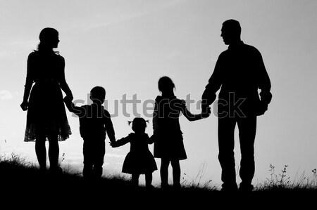 Sylwetka rodziny dzieci szczęśliwą rodzinę szczęśliwy charakter Zdjęcia stock © koca777