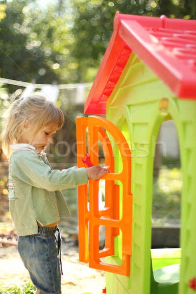 little girl with a children's playhouse Stock photo © koca777