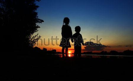 силуэта семьи детей счастливая семья женщину пляж Сток-фото © koca777