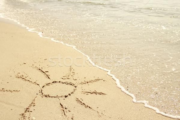 sun drawn in the sand on the seashore  Stock photo © koca777