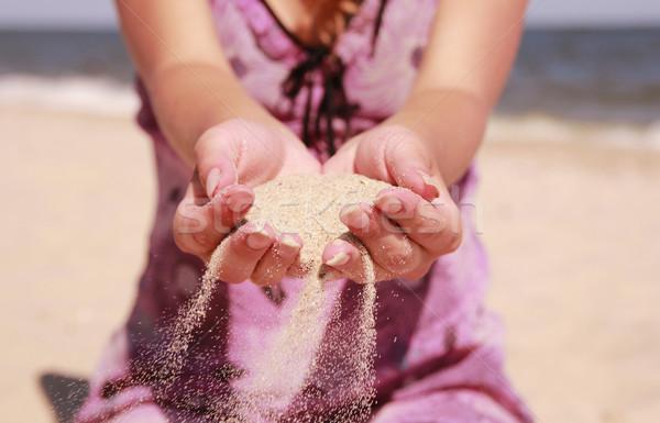 Kobiet ręce piasku działalności plaży niebo Zdjęcia stock © koca777