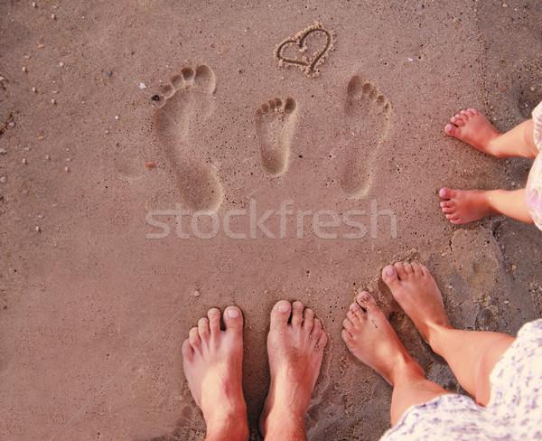 Család lábnyomok homok tengerpart férfi természet Stock fotó © koca777