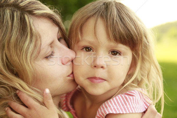 Mama and her little daughter  on grass Stock photo © koca777