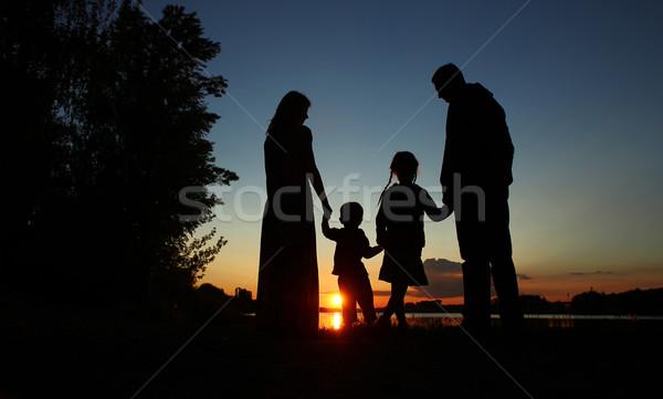 Siluet aile çocuklar mutlu aile ev mutlu Stok fotoğraf © koca777