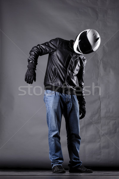 motorist with a helmet, leather jacket and jeans Stock photo © kokimk