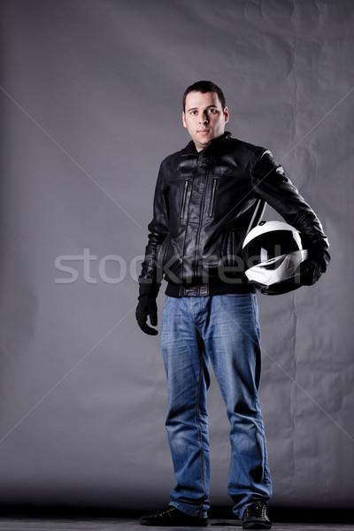 motorist with a helmet, leather jacket and jeans Stock photo © kokimk