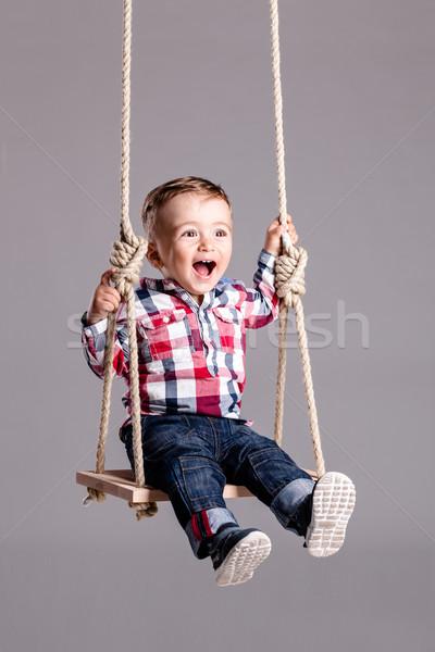 Bebek erkek salıncak mutlu küçük ahşap Stok fotoğraf © kokimk