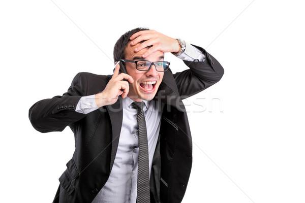 удивленный бизнесмен телефон изолированный белый бизнеса Сток-фото © kokimk