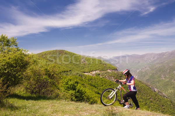 mountainbike girl in nature Stock photo © kokimk
