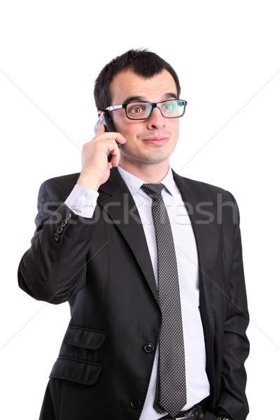 Surpreendido empresário telefone isolado branco negócio Foto stock © kokimk