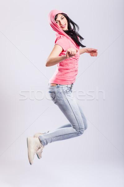 çekici genç kız atlama pembe kadın Stok fotoğraf © kokimk