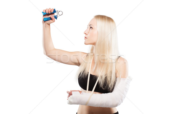 Fitness menina quebrado braço loiro gesso Foto stock © kokimk