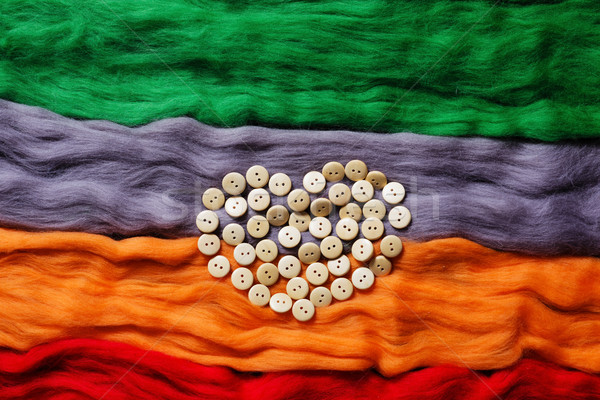 Background from coloures wool and buttons Stock photo © koldunov