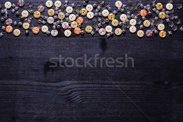 Scattering of buttons and shiny metal accessories for sewing Stock photo © koldunov