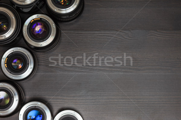 A lot of expensive photo lenses with colorful reflection as a background Stock photo © koldunov