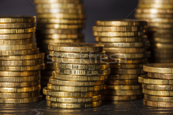 Stacks of gold coins on black background Stock photo © koldunov