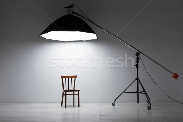 Preparation for studio shooting: empty chair and studio lighting Stock photo © koldunov