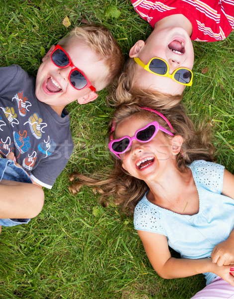 Laughing kids relaxing during summer day Stock photo © konradbak