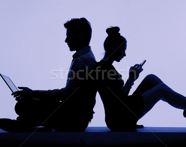 Young people addicted to the technology Stock photo © konradbak