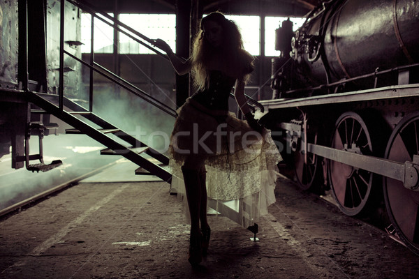 Picture presenting silhouette of the woman in the old railway st Stock photo © konradbak