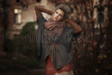 Lenyűgöző barna hajú szépség ül szék kezek Stock fotó © konradbak