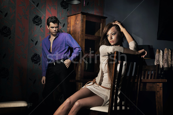 Stock photo: Photo of amazing young couple in nice room