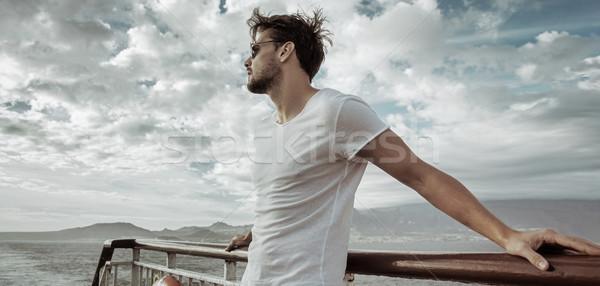 Handsome man relaxing on the ship Stock photo © konradbak