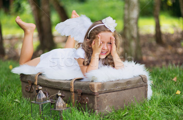 Small angel hiding her face behind the hands Stock photo © konradbak