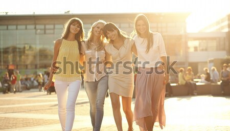 Four girlfriends in the victorious gesture Stock photo © konradbak
