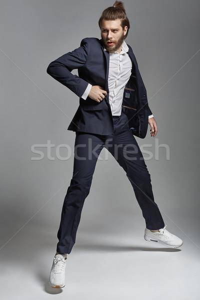 Portrait of a handsome guy wearing suit Stock photo © konradbak