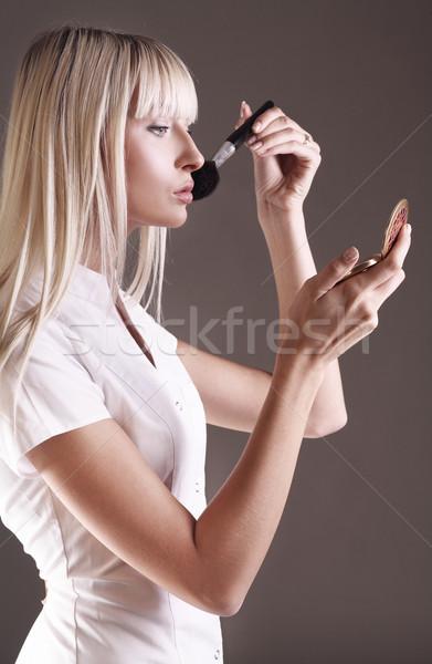 Genç yüz toz kadın Stok fotoğraf © konradbak