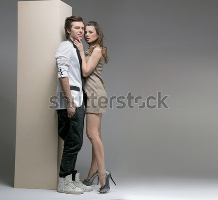 Vogue style studio shot of a man and 2 women Stock photo © konradbak