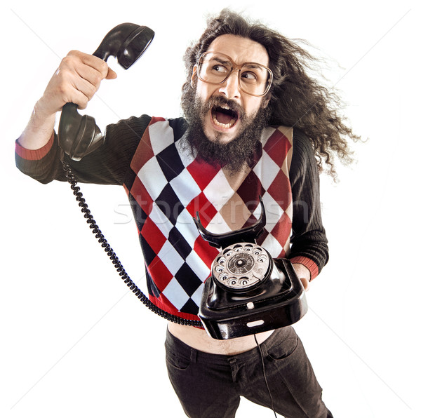 Nerdy guy talking to the shouting person Stock photo © konradbak