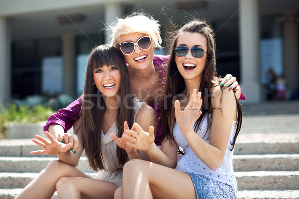 Portrait of three young ladies wearing sunglasses Stock photo © konradbak