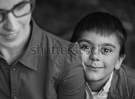 Black-white photo of mother and her happy son Stock photo © konradbak