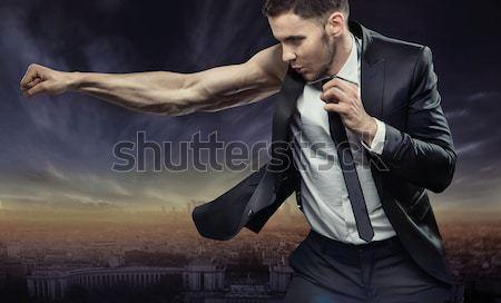 Yakışıklı kas adam gevşek takım elbise adam Stok fotoğraf © konradbak