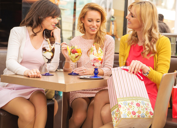 Attractive ladies in the shopping mall Stock photo © konradbak