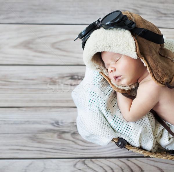 Aranyos kicsi fiú alszik védőszemüveg pilóta Stock fotó © konradbak